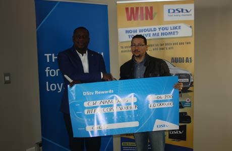 Charles Naruseb, winner of a gift voucher from Hi-Fi Corporation, with Russell Slinger, sales and branding manager of MultiChoice Namibia