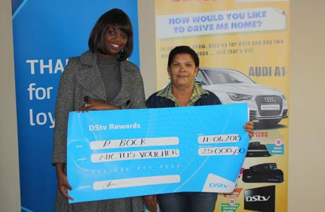 P Bock, winner of a gift voucher, with Manga Nawa-Mukena, the marketing manager of MultiChoice Namibia
