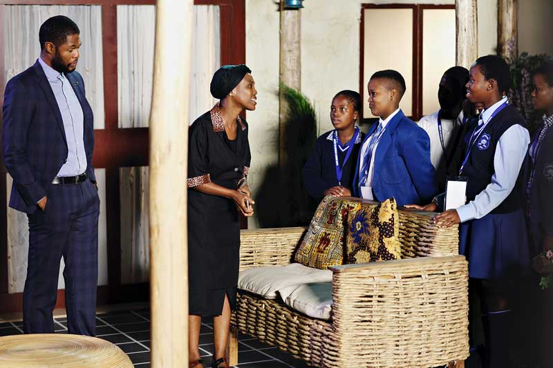 Andile Gumbi and Gcina Mkhize on a mock Isibaya set with grade 9 learners