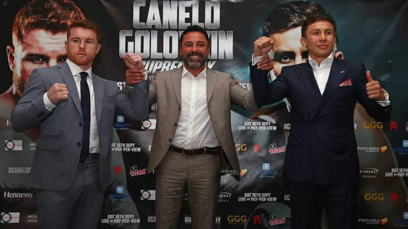 "Gennady ""GGG"" Golovkin and Saul ""Canelo"" Alvarez with Oscar De La Hoya"