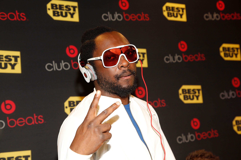 will.i.am wearing Beats by Dre headphones