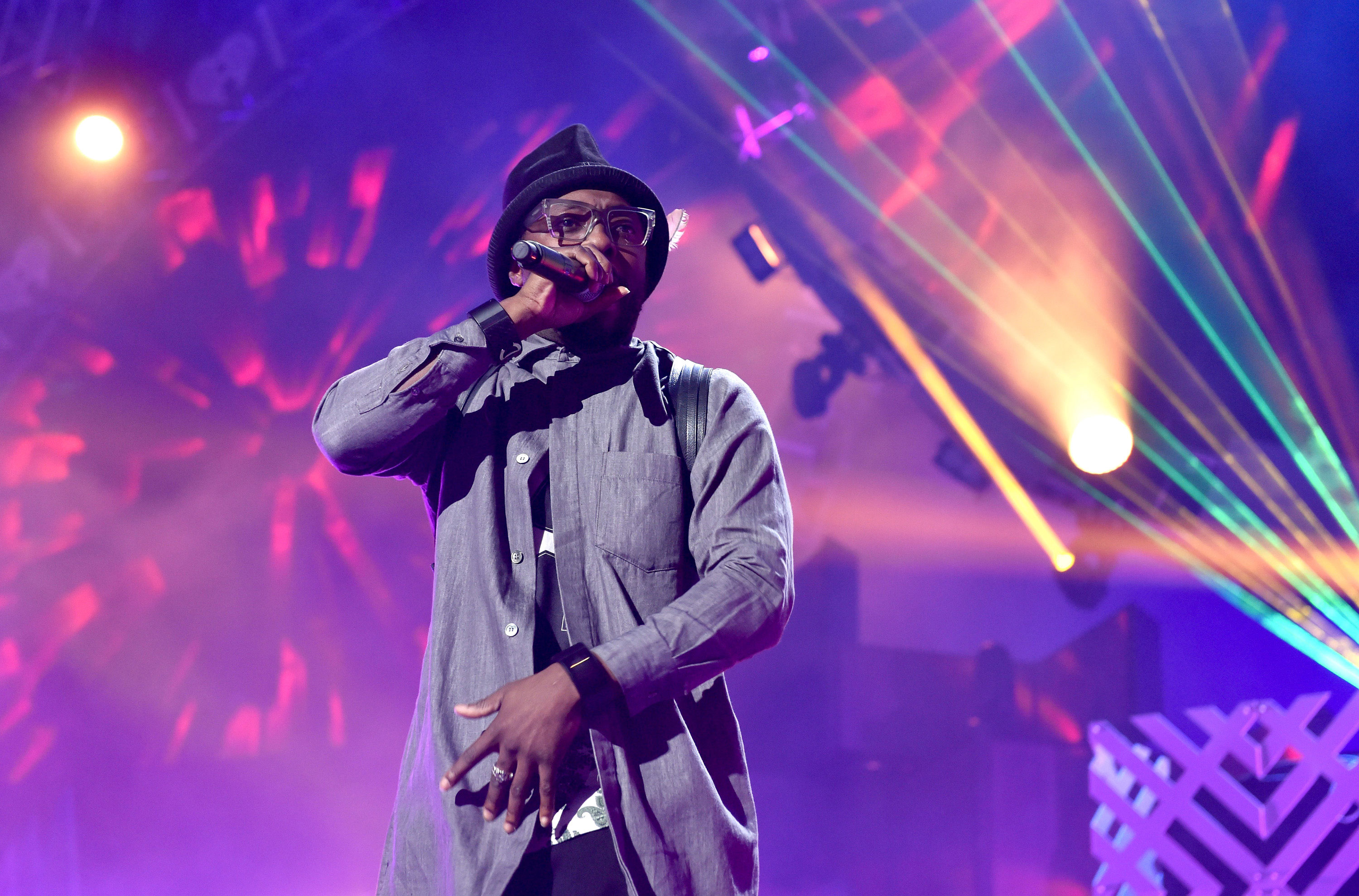will.i.am performing onstage.