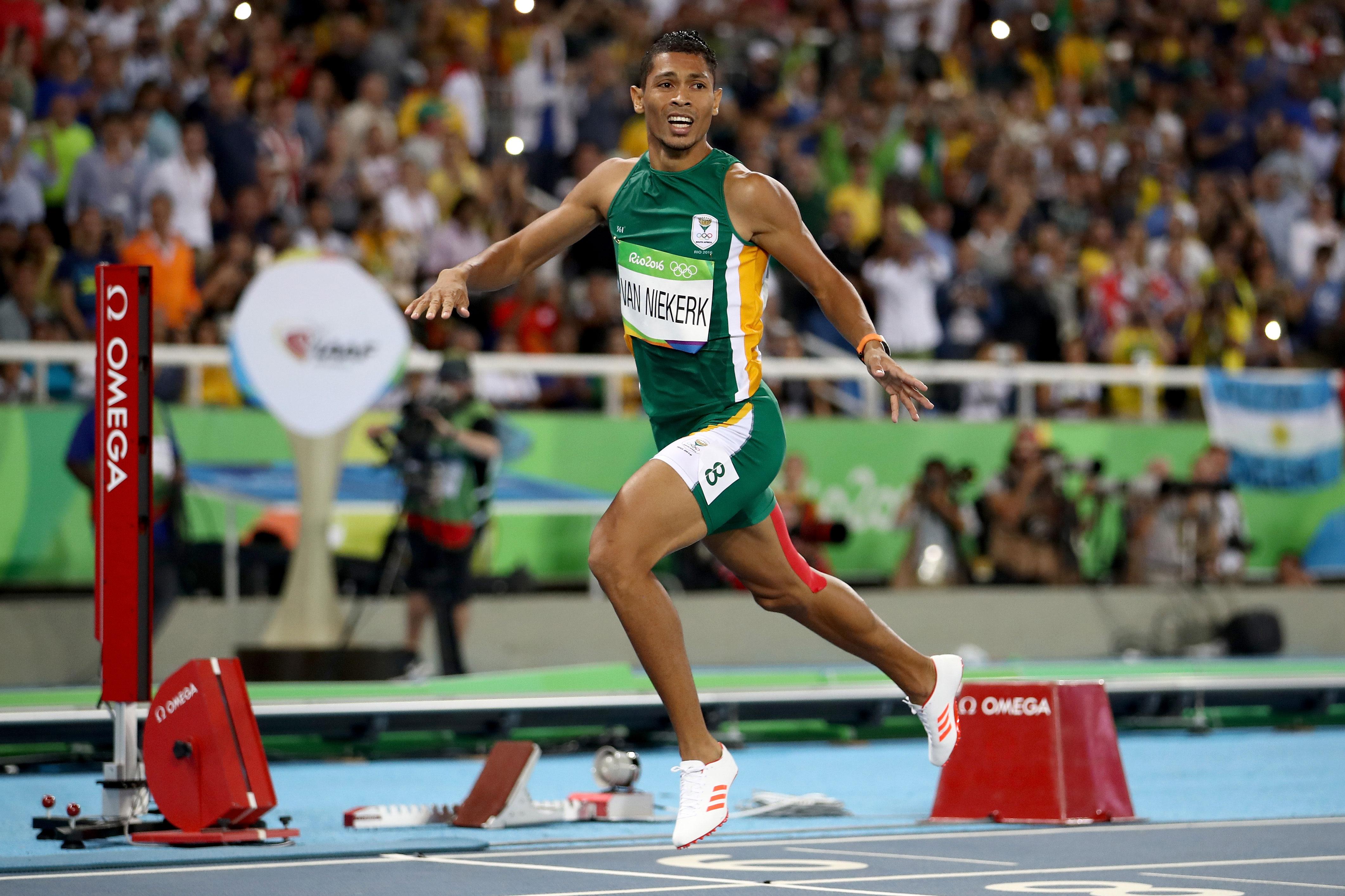 South African athlete Wayde van Niekerk crosses the finish line